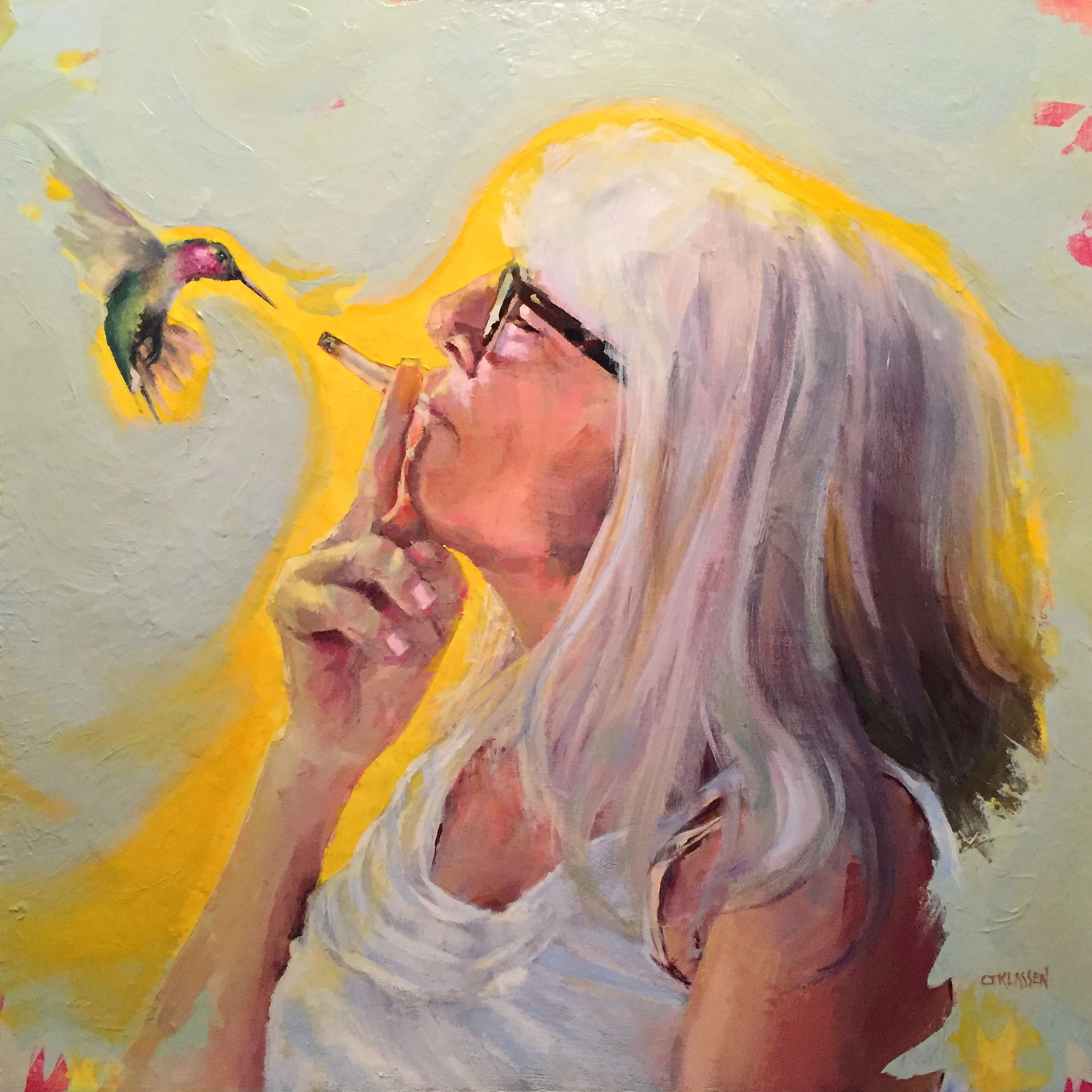 woman smoking facing a hummingbird in flight