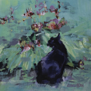 a tuxedo cat stares the day lilies in the garden