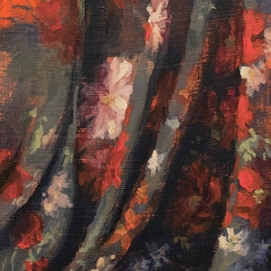 Draped floral print fabric on bright orange background